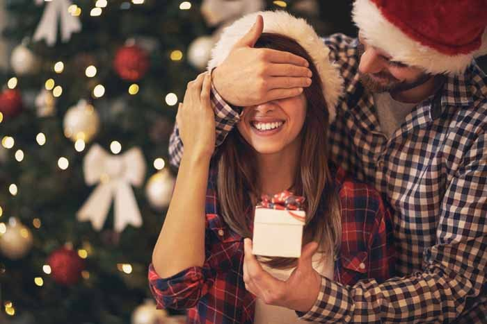 bigstock-Young-couple-have-Christmas-su-206848867_22073483d95d41beab76f881bd7020b3